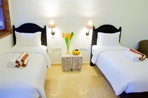 A bed or beds in a room at OK Divers Resort & Spa