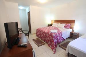 Cama ou camas em um quarto em Acquamarine Park Hotel