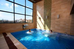 The swimming pool at or near Hotel La Trufa Negra