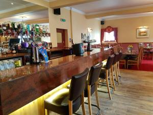 The lounge or bar area at The Panmure Arms Hotel