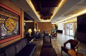 The lobby or reception area at Estadia Hotel