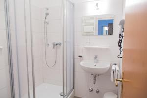 Ein Badezimmer in der Unterkunft Salzburg Hotel Lilienhof