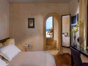 A bed or beds in a room at Petra Hotel & Suites