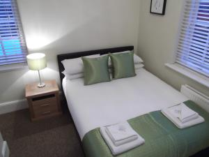 A bed or beds in a room at The Stag Enfield
