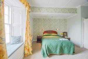A bed or beds in a room at Ord House Hotel