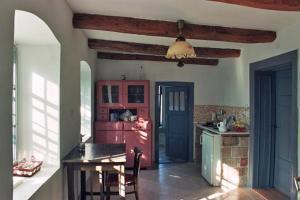 A kitchen or kitchenette at Pajta Porta