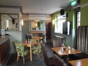 A restaurant or other place to eat at The Stag Enfield