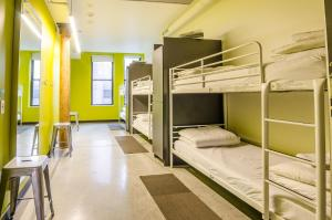 A bunk bed or bunk beds in a room at HI Boston Hostel