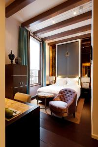 A bed or beds in a room at The Dylan Amsterdam