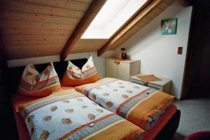 A bed or beds in a room at Inn Pension