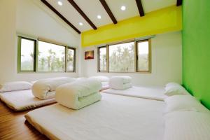 A bed or beds in a room at Love B&B