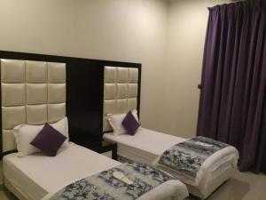 Cama ou camas em um quarto em Terhal Hotel Suites