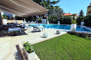 The swimming pool at or near Hotel Arupinum