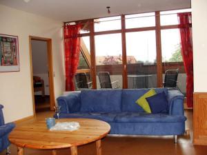 Ein Sitzbereich in der Unterkunft Ferienwohnung Am Jakobsweg