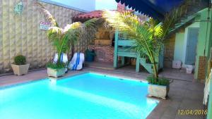 A piscina localizada em Suítes Casa Verde ou nos arredores