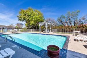 The swimming pool at or near Motel 6-Dallas, TX - Market Center