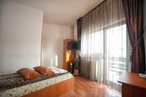 Кровать или кровати в номере Pensiunea Caramida Verde
