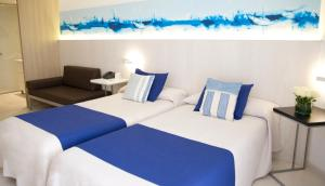 A bed or beds in a room at ALEGRIA Mar Mediterrania - Adults Only 4*Sup