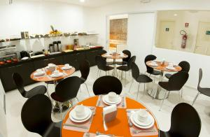 A restaurant or other place to eat at Pousada Eco Maceio