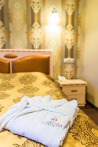 Кровать или кровати в номере KaroZa