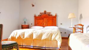 A bed or beds in a room at Farm stay Il Borgo dell'Arcangelo