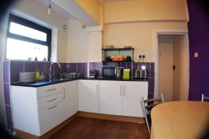 A kitchen or kitchenette at Birchfields Guest House