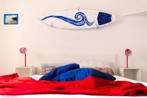 Letto o letti in una camera di In Riva al Mare B&B