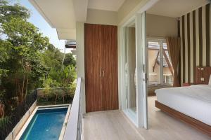 A view of the pool at Askara Canggu Townhouse or nearby