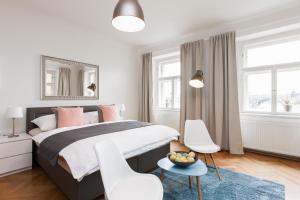 Letto o letti in una camera di Prague Center Apartments