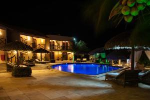 A piscina localizada em Pousada Aruana ou nos arredores