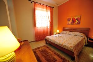 A bed or beds in a room at Case Vacanze Terra Sinus