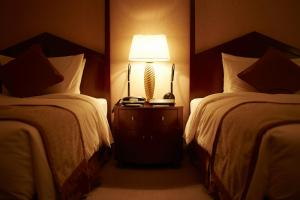 A bed or beds in a room at Imperial Hotel Osaka