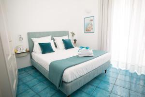 Cama ou camas em um quarto em Residenza Pansa B&B