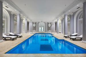 The swimming pool at or near The Waldorf Hilton