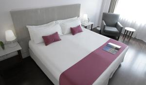 A bed or beds in a room at Dazzler by Wyndham Buenos Aires Recoleta