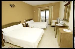 Cama o camas de una habitación en Hotel Villa El Mocanal