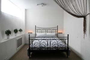 Кровать или кровати в номере Бутик Отель Stone