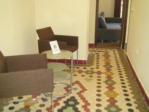 Un pat sau paturi într-o cameră la Coroa Malvarrosa