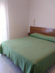 Кровать или кровати в номере Hotel Faro