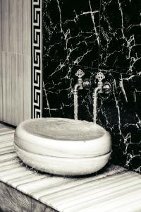 Ванная комната в Отель Грозный Сити