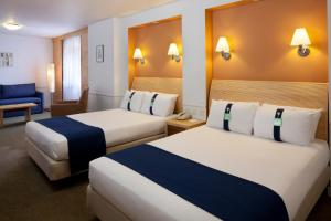 A bed or beds in a room at Holiday Inn Guildford, an IHG Hotel