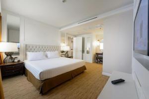 Cama o camas de una habitación en Bliston Suwan Park View