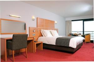 Un ou plusieurs lits dans un hébergement de l'établissement Hotel Riant-Séjour (Adults Only)