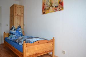 Ein Bett oder Betten in einem Zimmer der Unterkunft Ferienwohnung Schleussig
