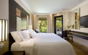 A bed or beds in a room at The Westin Resort Nusa Dua, Bali