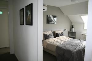 Een bed of bedden in een kamer bij thorn B&B