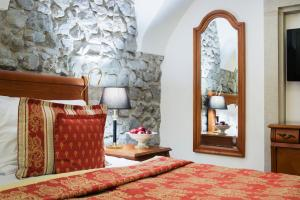 A bed or beds in a room at Arcadia Boutique Hotel