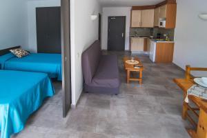 Een zitgedeelte bij RVHotels Apartamentos Treumal Park