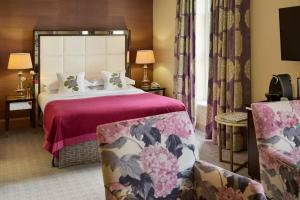 A bed or beds in a room at The Mandeville Hotel