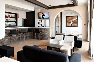 The lounge or bar area at Poseidonio Hotel